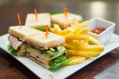 Mini sandwiches with fried fries and tomato sauce on a white plate Stock Photo