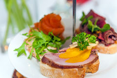 Mini sandwiches. With smoked ham mango and Oscypek cheese Royalty Free Stock Images