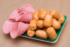 Mini sausage and bologna ham slides in dish Stock Photo