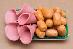 Mini sausage and bologna ham slides in dish Stock Photos