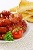 Mini sausages on plate Royalty Free Stock Photos