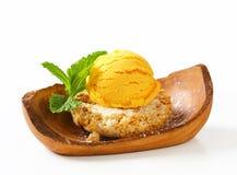Mini Sbrisolona cookie with scoop of yellow ice cream Stock Image