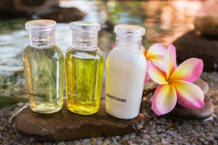 Mini set of bubble bath and shower gel decorated in zen style Royalty Free Stock Image