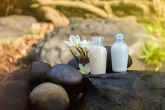 Mini set of bubble bath shower gel liquid with flowers and pebbl Royalty Free Stock Photo