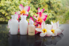 Mini set of bubble bath and shower gel liquid with pink flower Stock Photo