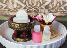 Mini set ofsoap, shampoo,conditioner with flowers frangipani Royalty Free Stock Images