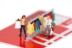Mini shoppers on credit card Stock Photo