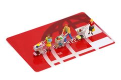 Mini shoppers on credit card Royalty Free Stock Image