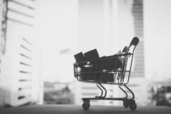 Mini shopping cart contain paper box using as e-commerce, online. Shopping and business marketing concept - Black and white filter stock photos
