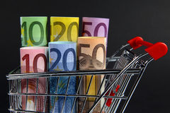 Mini shopping cart with euro bills Royalty Free Stock Images