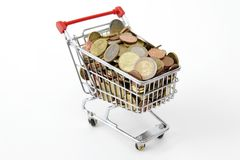 Mini shopping cart with euro coins. On white background Stock Photo