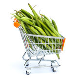 Mini shopping cart full with green beans Royalty Free Stock Image