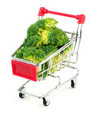 Mini shopping trolley stuffed with juicy green broccoli isolated Royalty Free Stock Photo