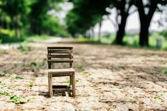Mini size wooden chair in country road with tree. In Korea stock photography