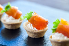 Mini smoked salmon pastry tartlets for catering. Stock Image