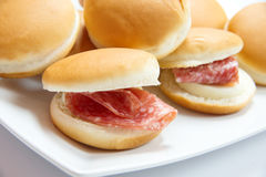Mini snack. Bread with salami and cheese Stock Photo