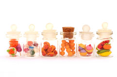 Mini snacks model. In clear bottle, made from clay stock image