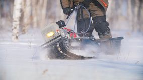 Mini snowmobile overcoming, manoeuvring and turning deep snow. Mini snowmobile overcoming deep snow, manoeuvring and turning, slow motion, specialized vehicle stock footage