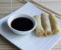 Mini Spring Rolls, Chopsticks, Soy Sauce On Bamboo Mat. Stock Photography