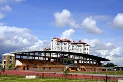 Mini stadium. And house againts blue skies Stock Image