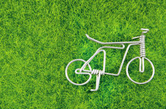 Mini steel bicycle toy on a grass Royalty Free Stock Photography