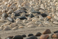 Mini stone with sunlight bury on sand Stock Images