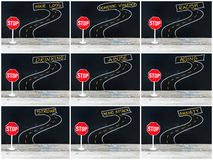 Mini STOP sign on the road, hand drawing over chalkboard Royalty Free Stock Images