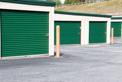 Mini Storage Warehouse Buildings with Green Doors Royalty Free Stock Image