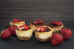 Mini strawberry cheesecake in muffin forms Royalty Free Stock Photo