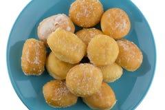 Mini sugary donuts in blue dish Royalty Free Stock Photo
