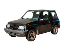 Mini SUV. This is a 1990s small black four wheel drive vehicle wiith a convertible top Stock Photos