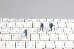 Mini swat squad protecting keyboard Stock Photography