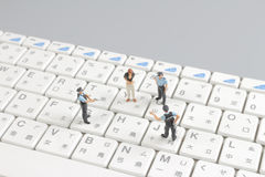 Mini swat squad protecting keyboard Stock Images