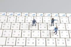Mini swat squad protecting keyboard Stock Photos