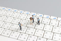 Mini swat squad protecting keyboard Royalty Free Stock Photography