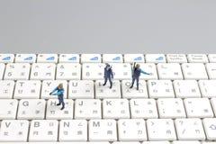 Mini swat squad protecting keyboard Stock Image