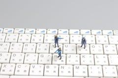 Mini swat squad protecting keyboard Royalty Free Stock Photos