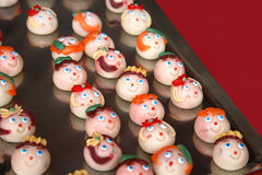Mini sweet faces. Mini sugar sweet faces for party Stock Photo