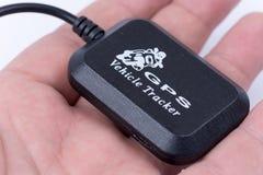 Mini szpiegów gps tropiciela alarmowy przyrząd w ręce Fotografia Royalty Free