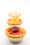 Mini tart with cherry jam isolated on white background. Mini tart with red cherry jam isolated on white background stock photo