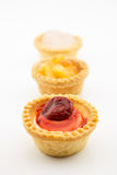 Mini tart with cherry jam isolated on white background. Mini tart with red cherry jam isolated on white background royalty free stock photos