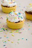 Mini tart with color ornaments Royalty Free Stock Photo