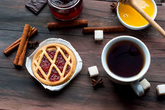 Mini tart with jam and a cup of coffee Stock Image