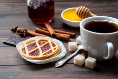 Mini tart with jam and a cup of coffee Royalty Free Stock Photo
