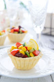Mini tart with salad from sweet corn, kidney beans and avocado salad on festive table Royalty Free Stock Image