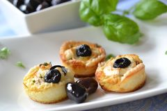 Mini tarteletts. With goats cheese and olives Royalty Free Stock Photos