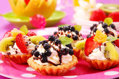 Mini tartlets with cream and fruits Stock Image