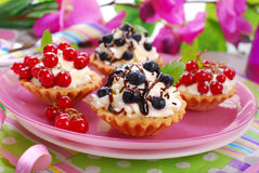 Mini tartlets with whipped cream and fresh fruits Stock Images