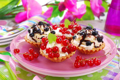 Mini tartlets with whipped cream and fresh fruits Royalty Free Stock Photography
