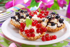 Mini tartlets with whipped cream and fresh fruits Royalty Free Stock Photos